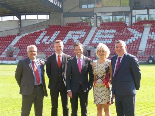 (left to right) Ian Bancroft- Chief Executive of Wrexham Council, Spencer Harris- Director of Wrexham AFC, Ken Skates- Welsh Government Economy and Transport Minister, Professor Maria Hinfelaar- Vice-Chancellor of Wrexham Glynd?r University, and Cllr Mark