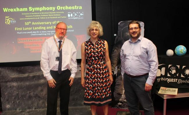 Scot Owen, Centre Manager of Techniquest Glynd?r, Maria Hinfelaar, Vice-Chancellor Wrexham Glynd?r University and Matthew Ellis Chair of Wrexham Symphony Orchestra pictured in the Science Theatre at Techniquest Glynd?r to announce the special Moon Landing