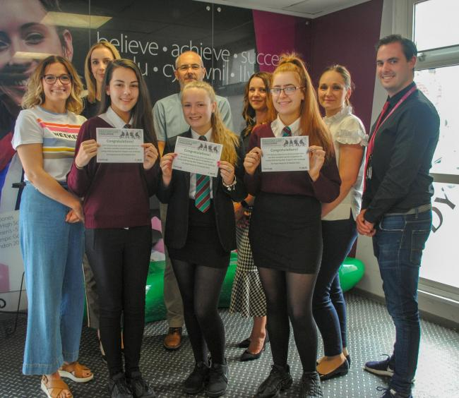 Pictured with their skills teacher, Adam Goudy, students Megan Kay, Jessica Brookes, Sophie Dykins and Caitlin McGawty (not pictured) were congratulated for being the team that raised the most funds, £250, by raffling a signed Manchester United shir