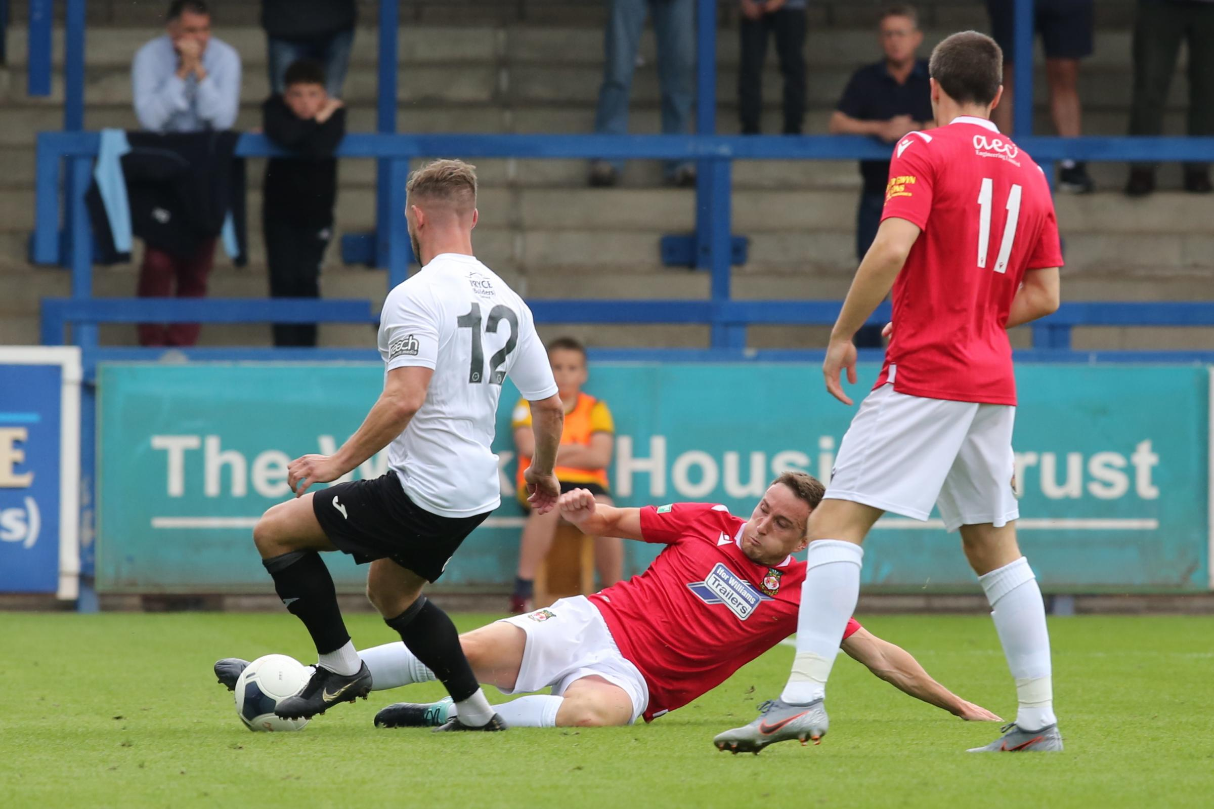 Wrexham AFC midfielder Luke Young happy with his form but midfielder won't rest on his laurels with Reds still not safe