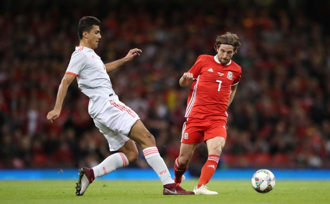 Spain's Rodri (left) and Wales' Joe Allen battle for the ball during the International Friendly match at the Principality Stadium, Cardiff. PRESS ASSOCIATION Photo. Picture date: Thursday October 11, 2018. See PA story SOCCER Wales. Photo credit s