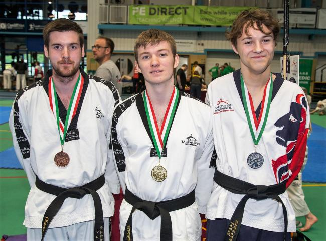 Matthew Cook, pictured in centre, with the other medallists at the Taekwondo International World Championships
