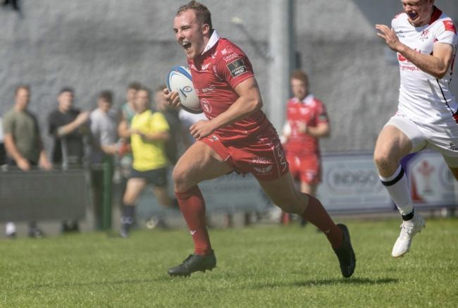 Efan Jones goes over for one of his three tries for Scarlets A in the Celtic Cup