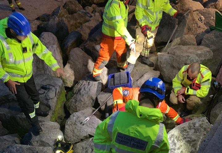 Flint coastguard team helps free trapped beagle at New Brighton