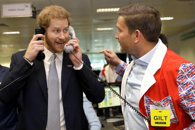The Duke of Sussex takes a phone call for charity