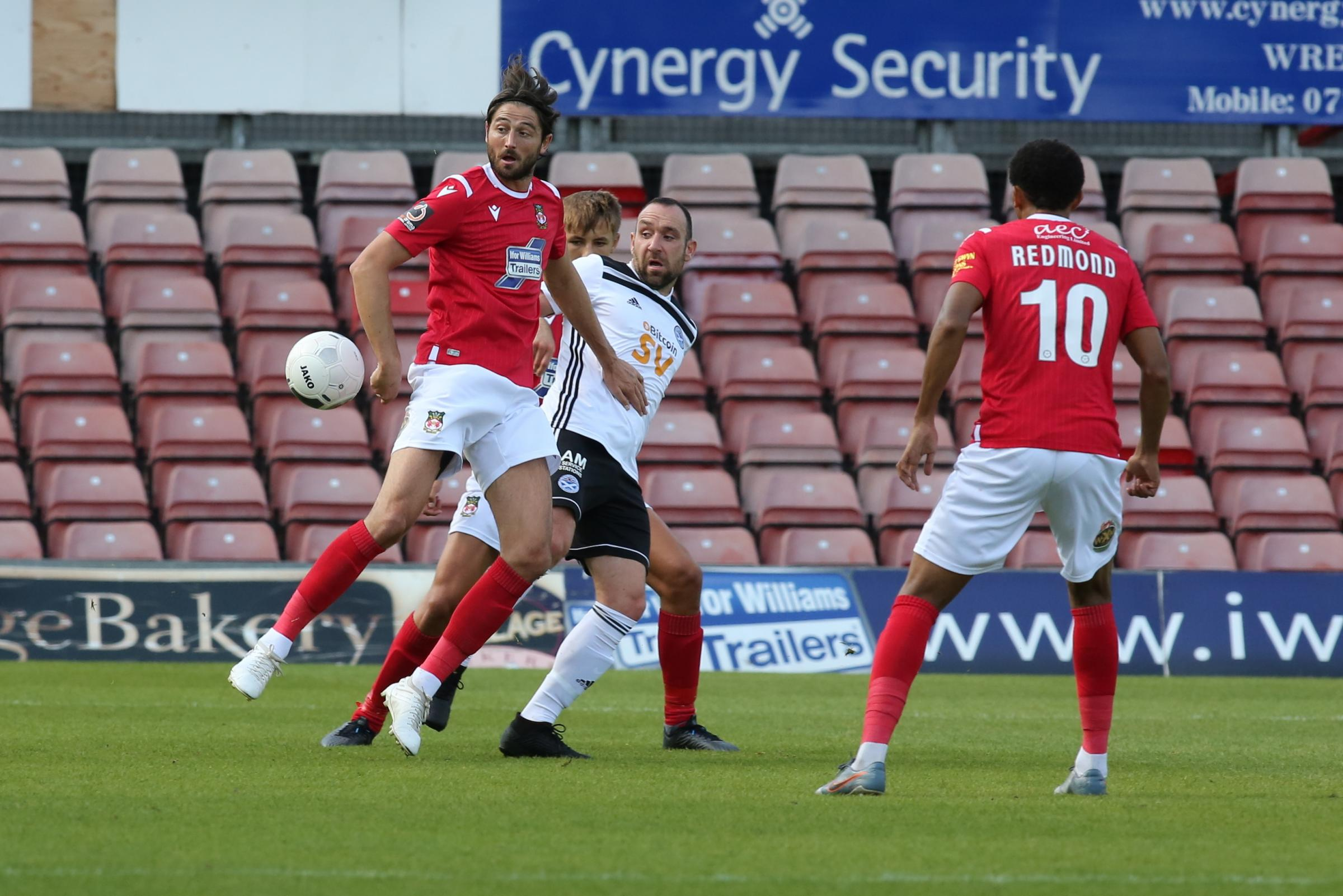Wrexham AFC midfielder Adam Barton admits it has been a frustrating start to his spell at The Racecourse