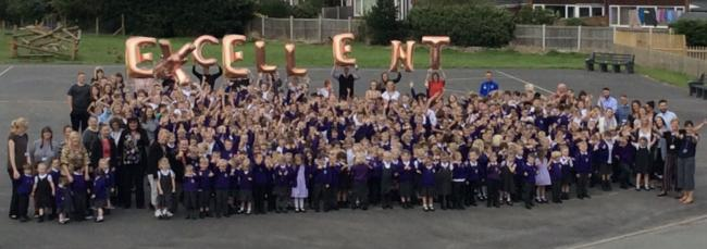 Broughton Primary School pupils and staff celebrate the outstanding report following Estyn inspection in July.