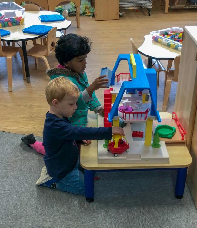 Aaranee Paloran and Timmy Walker have fun playing with some of the toys on offer at the nursery open morning.