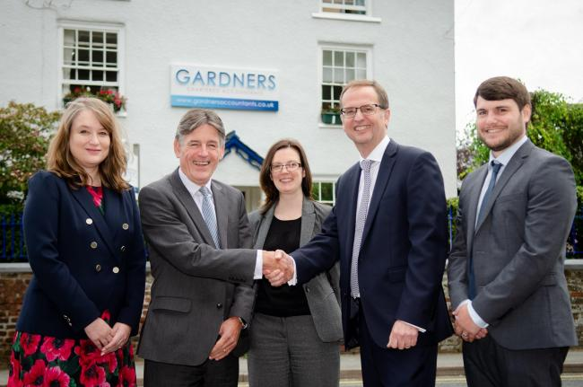 (Left to Right): Melanie Langton-Davies and John Gardner (Directors), with Laura Pae (Senior Corporate Manager), David Travis (Baldwins) and Simon Roberts (Senior Corporate Manager) at Gardner's Accountants. Image by Mike Sheridan/Advent PR.