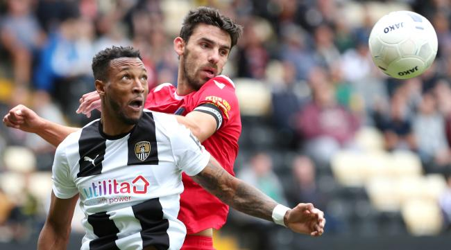Notts County's Wes Thomas & Wrexham's Shaun Pearson during the National League match at Meadow Lane on Sunday 18th August 2019..