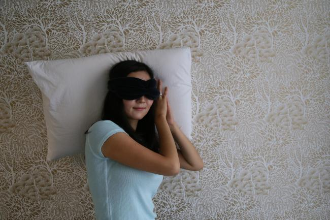 Jane Chung with her pillow and eye-mask. Photo: PA Photo/Calm
