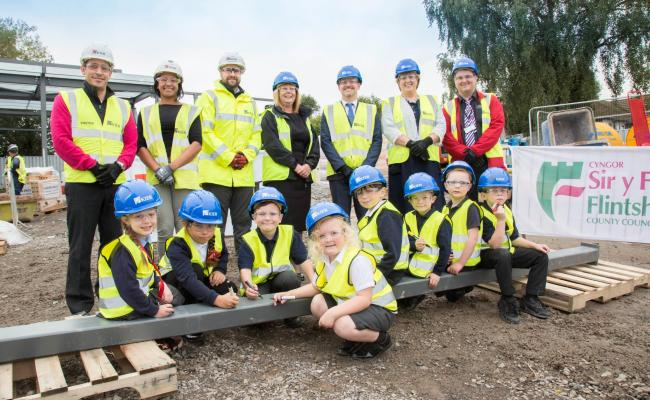 Ysgol Glan Aber School Council pupils along with Flintshire County Council and Kier Construction sign the beam.