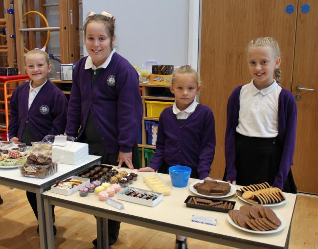 Elle-May Rush, Lottie Johnson, Millie McPherson and Kayleigh Williams at the coffee morning at Ysgol Maes y Felin.