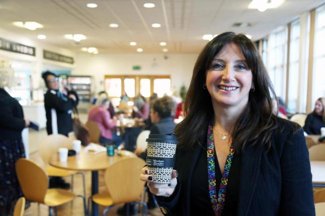 Wrexham Glyndwr University Director of Operations, Lynda Powell with one of the branded Husk Up Cups.