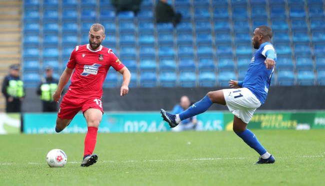 Chesterfield's Gevaro Nepomuceno & Wrexham's James Horsfield during the FA Cup 4th Qualifying Round at the Proact Stadium on Saturday 19th October 2019..