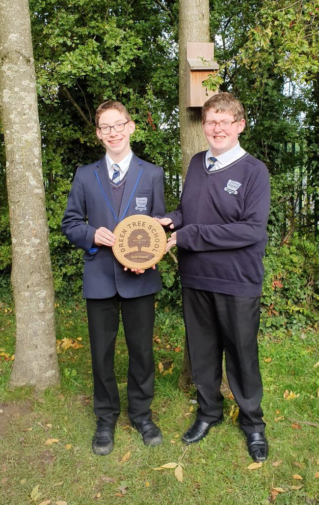 Jay Condron and Harry Mawdsley of Argoed High School with the Woodland Trust's Green Tree Schools Award.