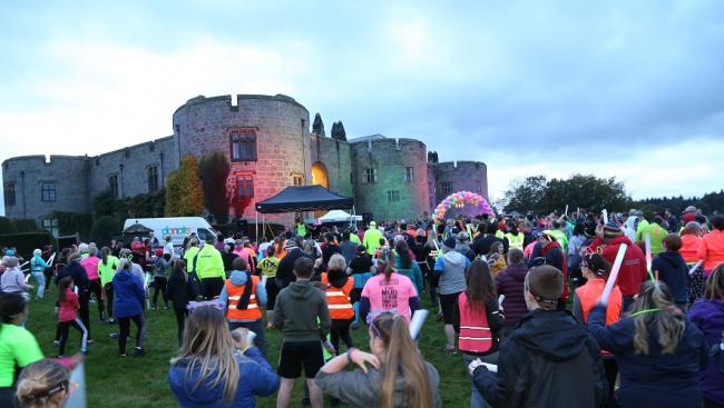 Runners warm up in front of Chirk Castle