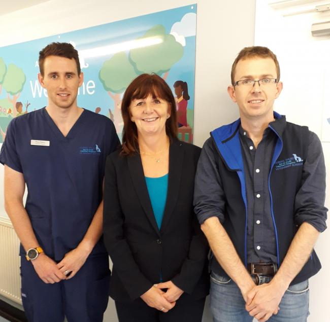 Lesley Griffiths AM alongside (left) Dr Rhys Peters, Lead Veterinary Surgeon and (right) Owen Monie, Director General of Animal Trust.