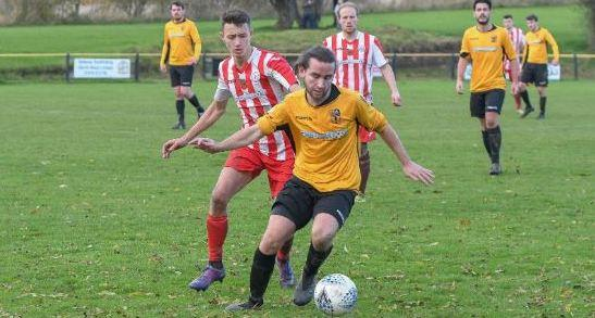 Action from Brymbo's Welsh Trophy clash with Holywell Town. Picture: @HolywellTown