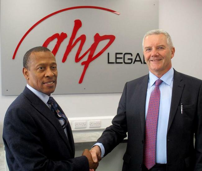 Ronald Carter (left) is welcomed to the firm by GHP Legal managing partner, Richard Lloyd