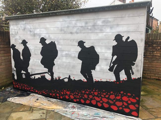 The mural painted to mark 20 years of military service [Image by Tracy Jones]