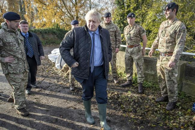 Boris Johnson with members of the Light Dragoons during a visit to Stainforth, Doncaster