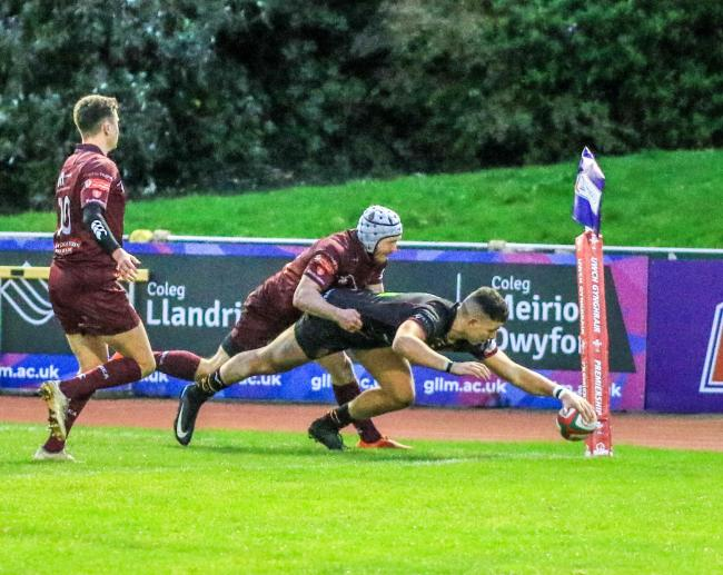 Rhys Tudor scores for RGC against Swansea (Photo by Tony Bale)