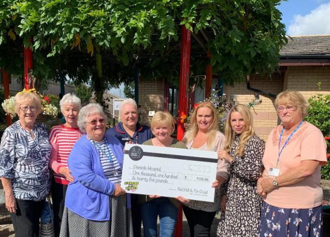 Deeside Community Hospital League of Friends receive cheque from Joanne Powell and Craft Union Pub Company Area Manager Rebecca Hawkins.