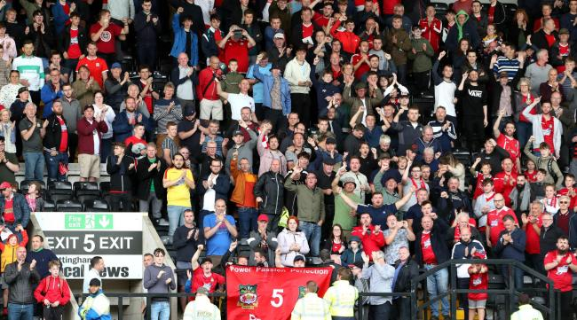 Wrexham fans applaud their players after the National League match at Meadow Lane on Sunday 18th August 2019..
