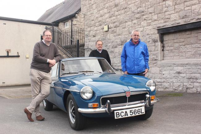 From left, author Darren Banks, Dave Jones, who now owns Tom Pryce's beloved MGB GT sports car and Trefor Williams, friend, outside Tom's old school, Ysgol Frongoch, in Denbigh.