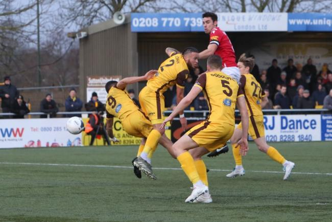 Shaun Pearson goes up for a header