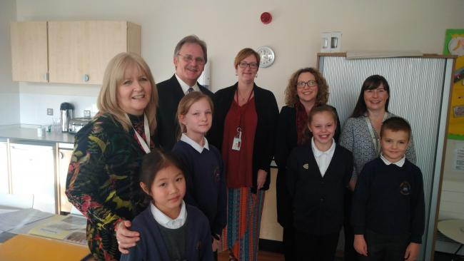 North Wales Assembly Member Mark Isherwood with pupils and staff at Ysgol  T? Ffynnon in Shotton on Friday.