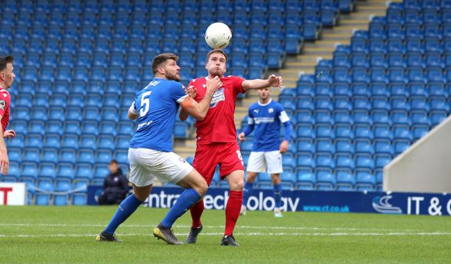Chesterfield's Will Evans & Wrexham's Luke Young during the FA Cup 4th Qualifying Round at the Proact Stadium on Saturday 19th October 2019..