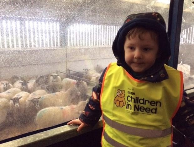 One of the children from Cylch Clocaenog that visited Rhug Estate.