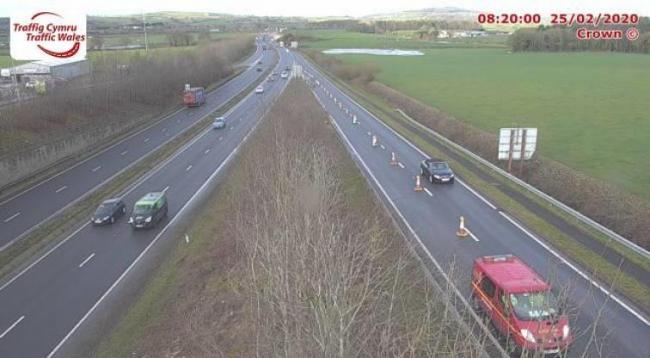 The closed lane on the A55 Junction 31 slip road. Image Traffic Wales.