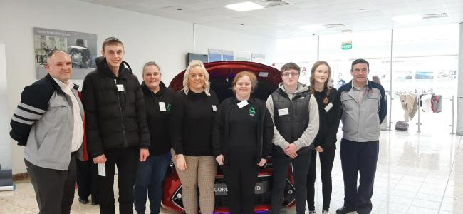 Teleri Jones and Lisa Jones from Groundwork North Wales, Laura Gelder, Emily Law, Kieran Thomas and Kai Kelly of the employability programme and Toyota manufacturing staff representatives.