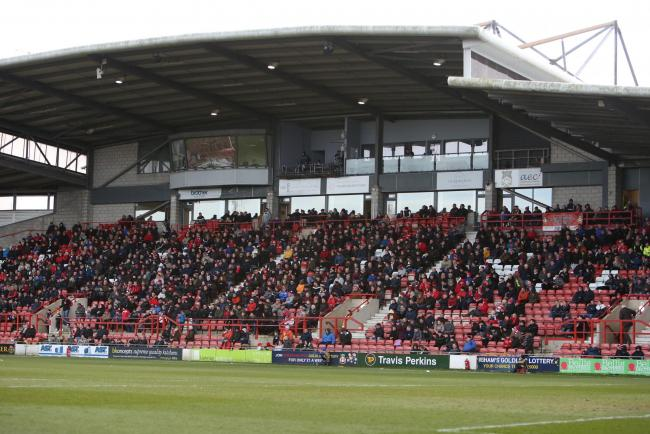 Stock image of Wrexham's Racecourse Ground with fans