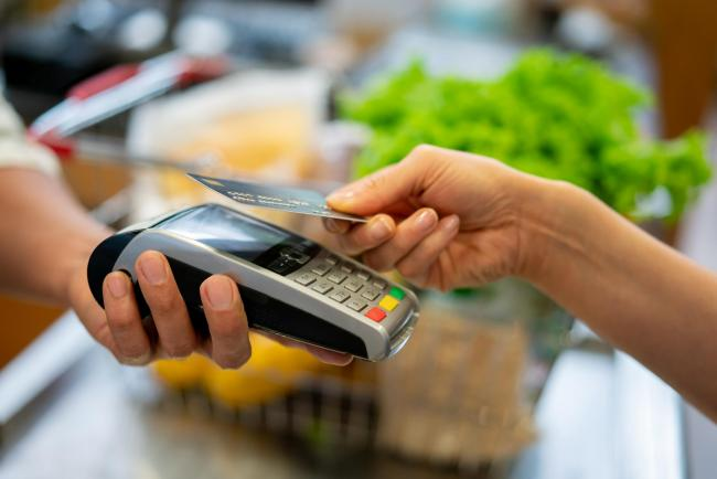 Close up of customer doing a contactless payment