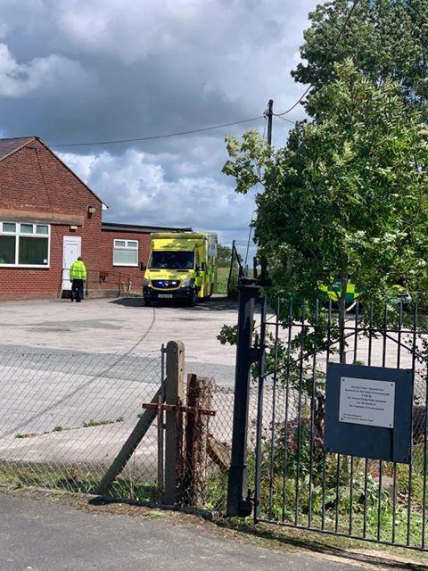 The Leader: An ambulance at the scene at Gwernymynydd village hall. (Credit - Pat Forde)