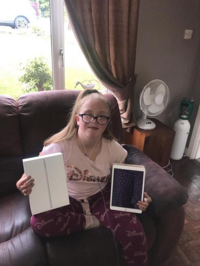 Youngster Elodie, who has been using her iPad every single day to stay connected. (Source Wrexham Council)