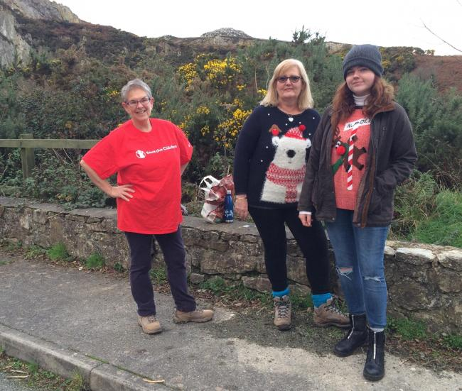 Save the Children coastal walkers in their Christmas jumpers.