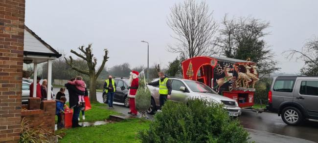 Deeside Round Table's Santa float visits a family in Ewloe - which has suffered a recent bereavement. (Image: Laura's Army)