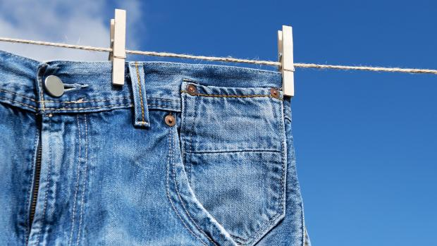The Leader: Air drying your jeans is the best way to protect the material and fit of the jeans. Credit: Getty Images / Pavel1964