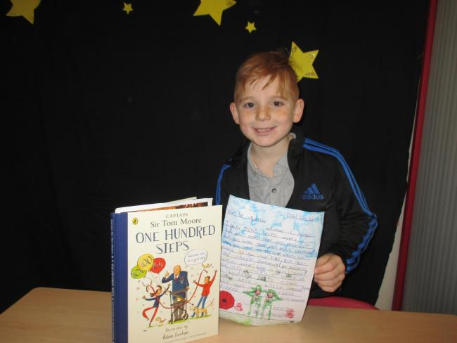 Teego Hayward with his letter and Captain Sir Tom Moore's book