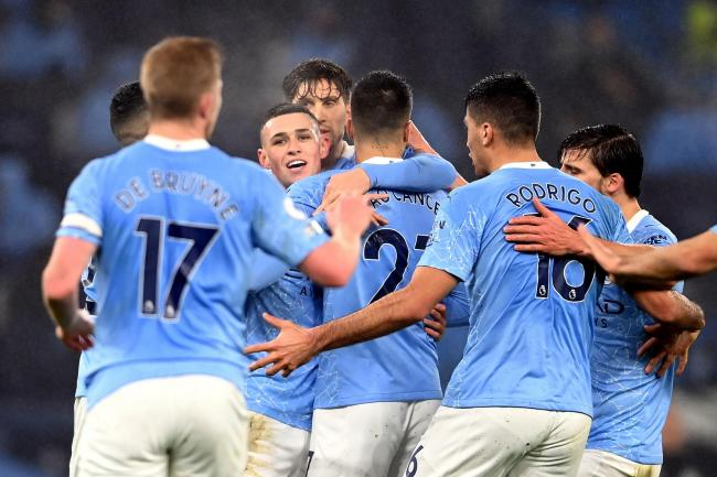 Manchester City players celebrate Phil Foden's goal against Brighton on Wednesday night, despite warnings for players to avoid hugging