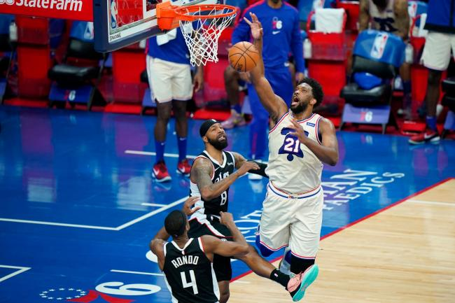 Joel Embiid, right, poured in 36 points and had 14 rebounds