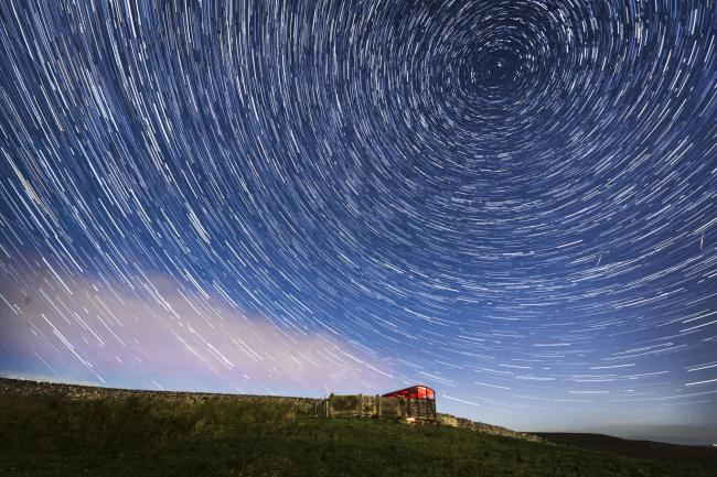 EDITORS NOTE: Digital composite of 50 photographs taken over a period of 25 minutes. File photo dated 13/08/17 of meteors and star trails during the Perseid meteor shower seen from near Hawes in the Yorkshire Dales National Park. Skygazers can look