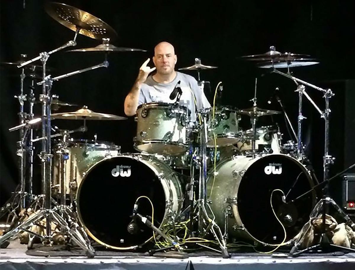 flintshire rock bands strumming together to help drummer fighting