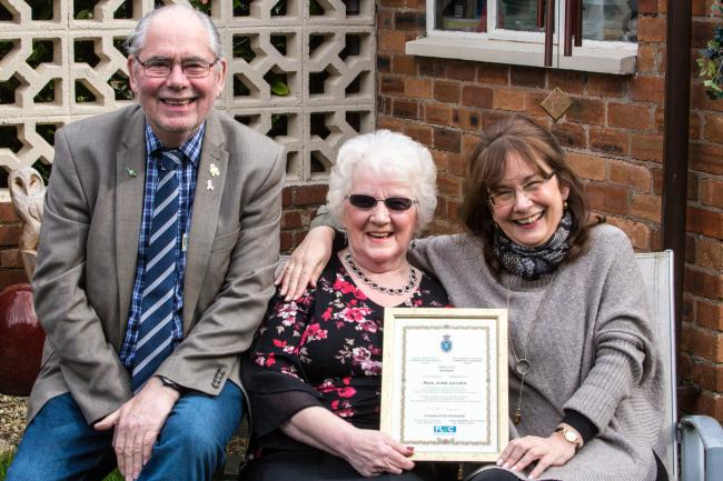 June Davies, her daughter Pauline and Queensferry county councillor David Wisinger celebrate June's award.