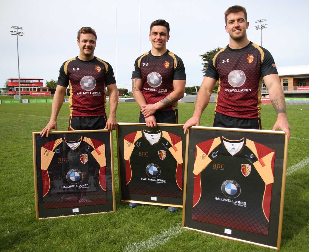 Alex Schwartz, Jacob Botica and Tiaan Loots with their framed shirts